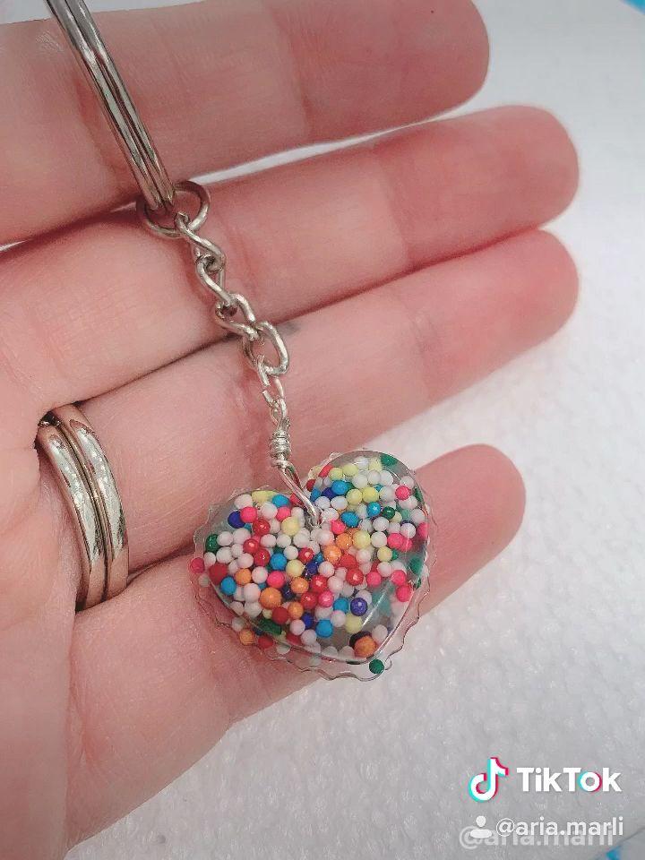 Diy uv resin sprinkle heart keychain video in 2020 how