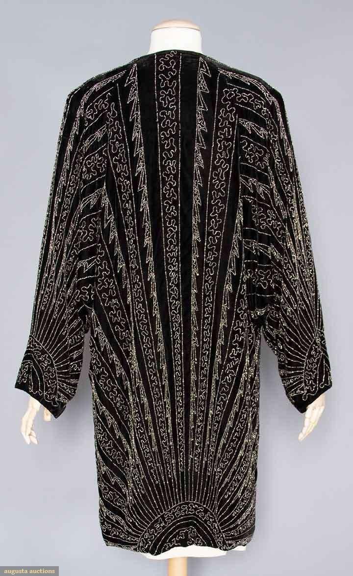 Back view of 1920's silk evening coat with cut steel art deco design pattern. Sooo beautiful!