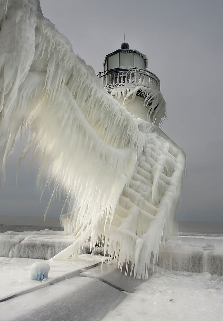 Ice-covered lighthouse at the St. Joseph North Pier on the coast of Lake Michigan