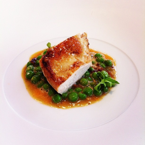 Chicken (English!) on a bed of peas and a sauce with ginger and pink grapefruit. Taken at The Cube when Claude Bosi of Hibiscus was cooking. Great #experience #London #restaurant #popup #cube #cooking #chef #review