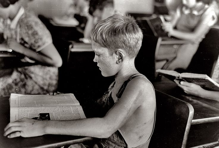 August 1938. Child studying in school. Southeast Missouri Farms, Missouri. 35mm nitrate negative by Russell Lee.