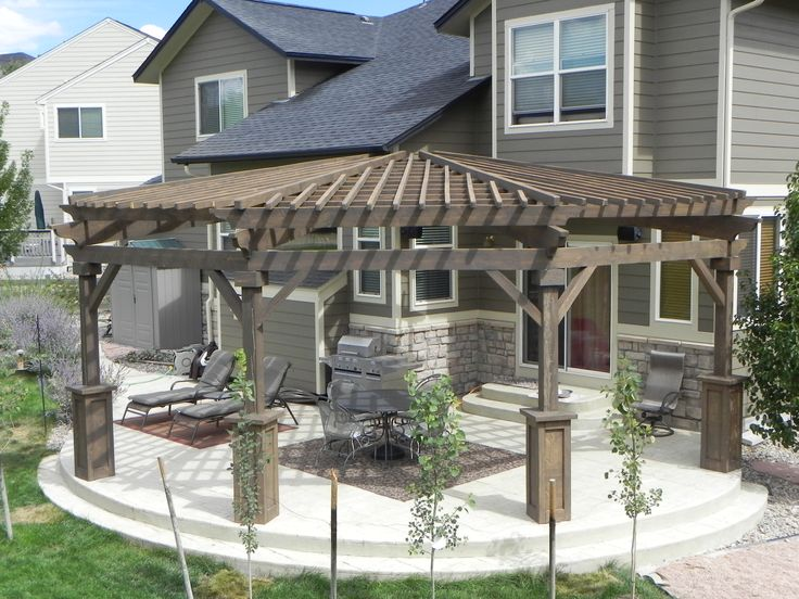 Large Radiused Pergola Made Of Dark Stained Beetle Kill