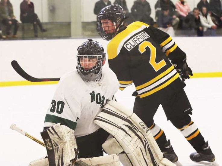 Belle River Nobles goaltender Patrick Timpany, left, watches for a rebound against General Amherst Max Clifford in the WECSSAA boys' A/AA high school hockey final at Atlas Tube Arena on March 6, 2017.