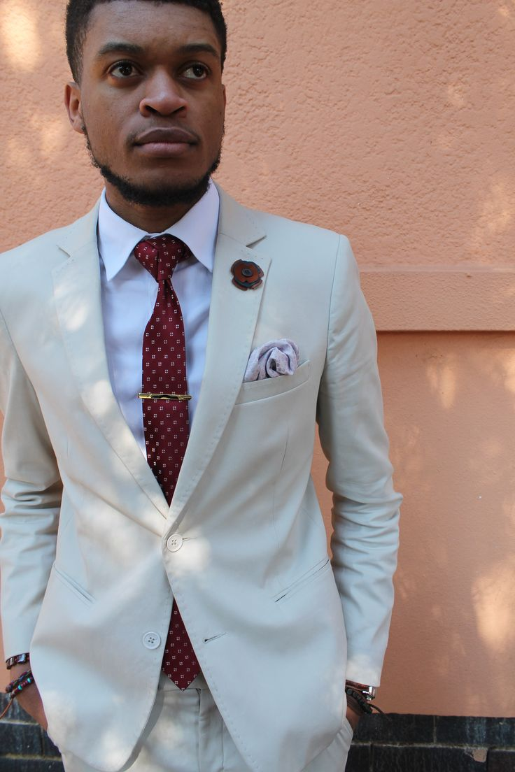 Beige ottoman blazer, red tie, white shirt and that beard game. STEEZ