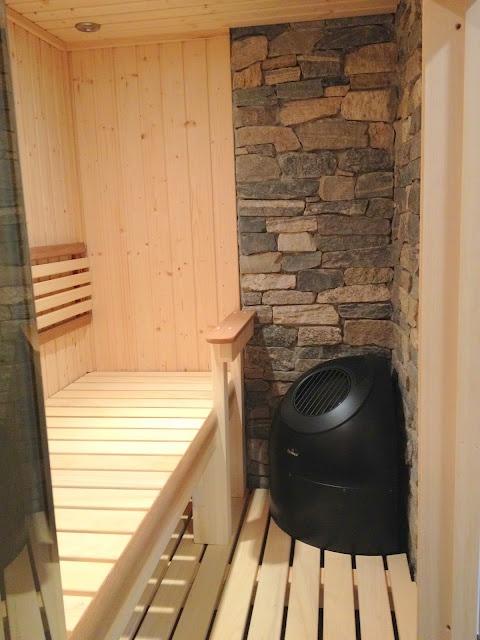 Finnleo Custom Series Sauna with Pikutonntu heater and stacked stone wall, Nashua, NH purchased from Oasis Hot Tub & Sauna, Nashua, NH