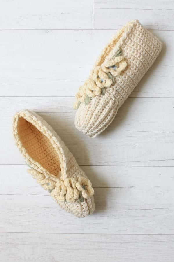 This cute set of crocheted slippers is written in children's to women's sizes. Using worsted weight yarn in your favorite color combinations, the possibilities are endless.  https://www.maggiescrochet.com/products/vintage-floral-slippers-crochet-pattern