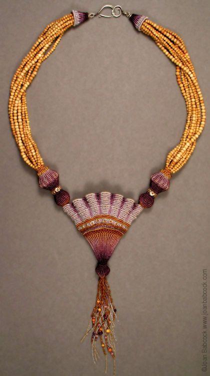 Fiber art jewelry by Joan Babcock