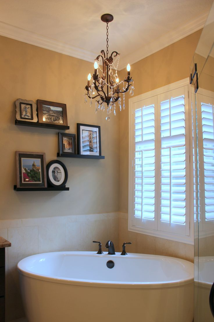 This beautiful master bathroom features a free standing for Master bathroom fixtures