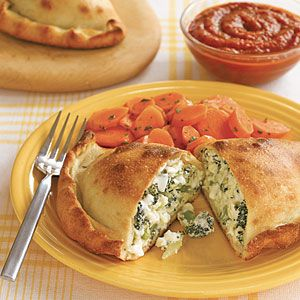 Broccoli and Double Cheese Calzones  Ingredients  1 1/2 cups broccoli florets  1 large clove garlic, minced   2/3 cup ricotta   4 ounces mozzarella, coarsely grated (1 cup)  1 large egg yolk  Salt and pepper  1 pound frozen pizza dough, thawed  1 1/2 tablespoons olive oil  served with carrots