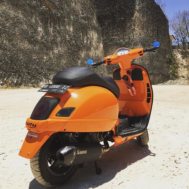 Featuring very cool orange modified Vespa GTS