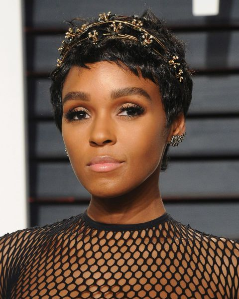Proving there's a million different ways to wear a pixie crop, Janelle Monae's bejewelled head band gives short hair an evening update.
