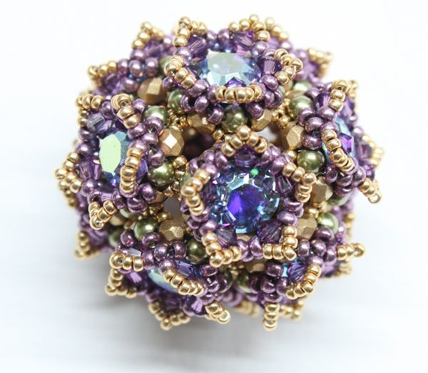 Crownie -@ trytobead Crownie is a sphere made from 12 little crowns, that are connected to a beautiful pendant. It looks more complicate then it is. Due to the many crystals the sparkling effect of the chatons is even more increased. Pattern and kits available