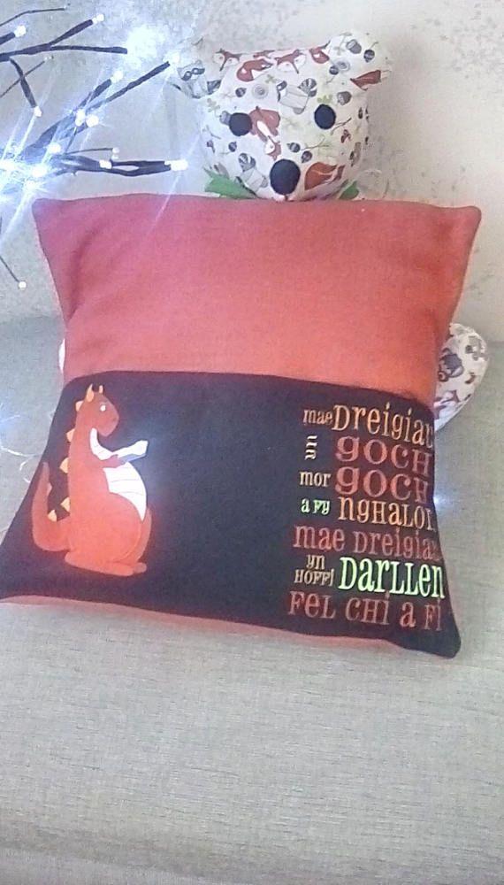 Check out this item in my Etsy shop https://www.etsy.com/uk/listing/533906314/welsh-dragon-book-cushion-cymraeg