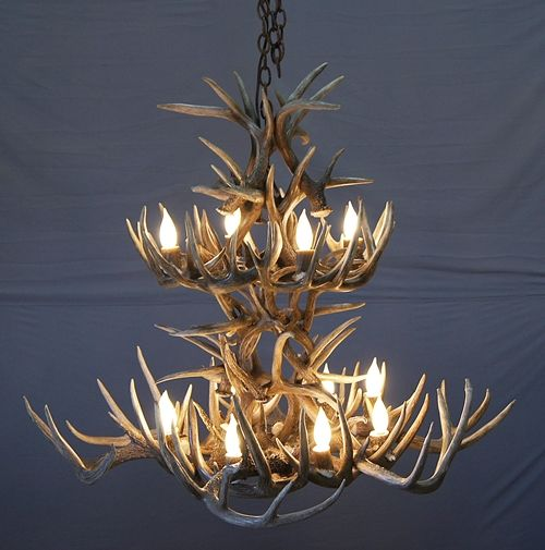 "#532-M ""La Plata Peak"" White Tail Deer Antler Chandelier 2 Tier This white tail deer antler chandelier has a nice swirl pattern on the base with large whitetail deer naturally shed antlers. 16 lights approximately 44″w X 36""h All products are individually built to order which allows for unlimited customizing options."