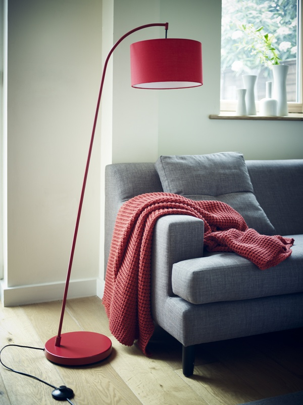 red lamp and grey couch.. nice combination.