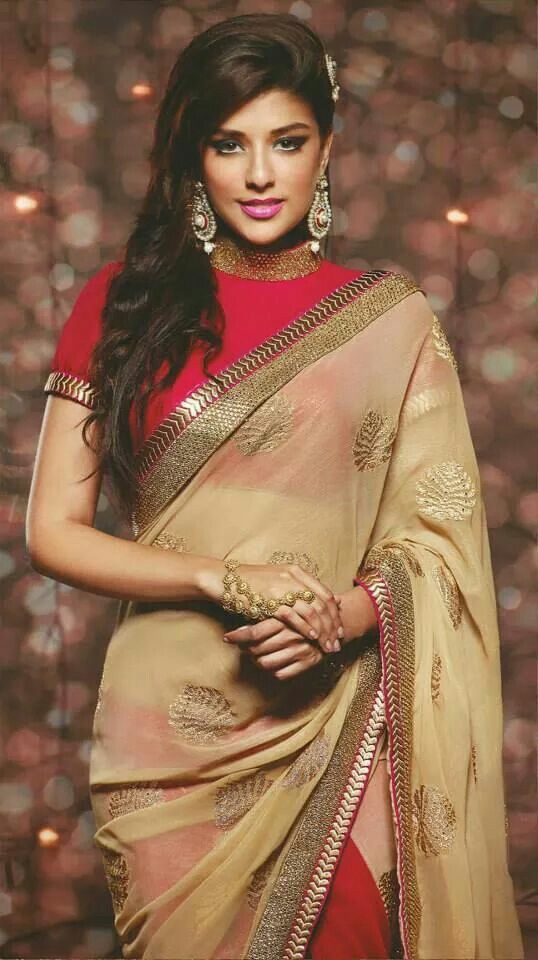 High neck saree blouse with simple neck n sleeve-end detailing
