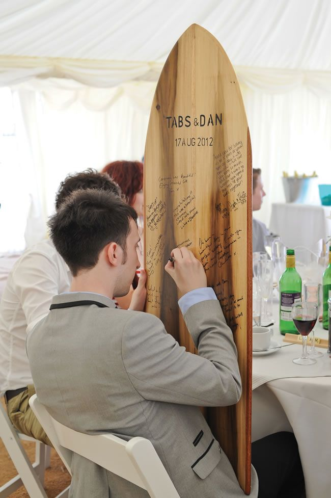 Tabitha and Daniel's wonderfully relaxed seaside wedding. Great idea for a guest book!! #weddingideas