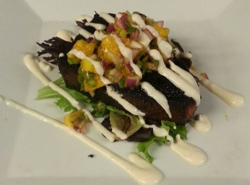 Blackened Swordfish with a spicy lime crème fraiche and mango salsa