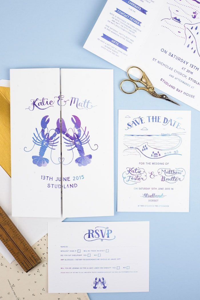 Seaside themed wedding stationery by Wolf Whistle in blue watercolour.  The gatefold invitation features a lobster logo, map illustration and hand lettering as well as matching RSVP card.  Designed for a coastal Dorset wedding.
