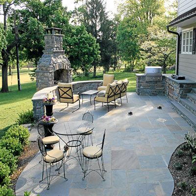 Flagstone patio deck paver patios paver walls for Outdoor stone patio ideas