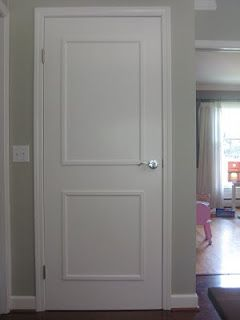 add molding to flat hollow doors for a panel look--super cheap and looks good.