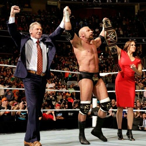 Vincent K. McMahon Triple H & Stephanie McMahon Levesques celebrated with Triple H  as he Became the New WWE World Heavyweight Champion