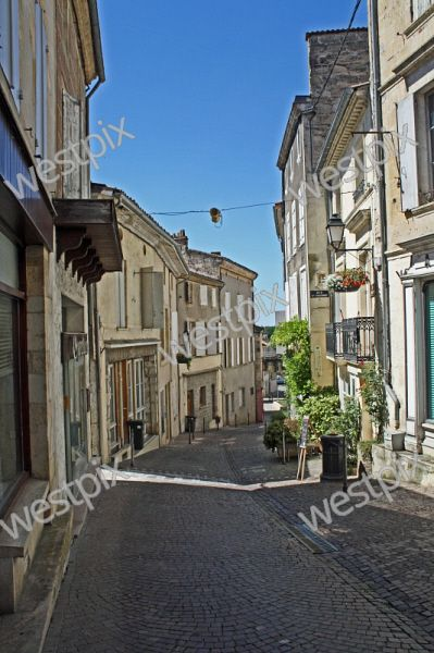 The narrow streets provide respite from the hot sun in La Reole France.