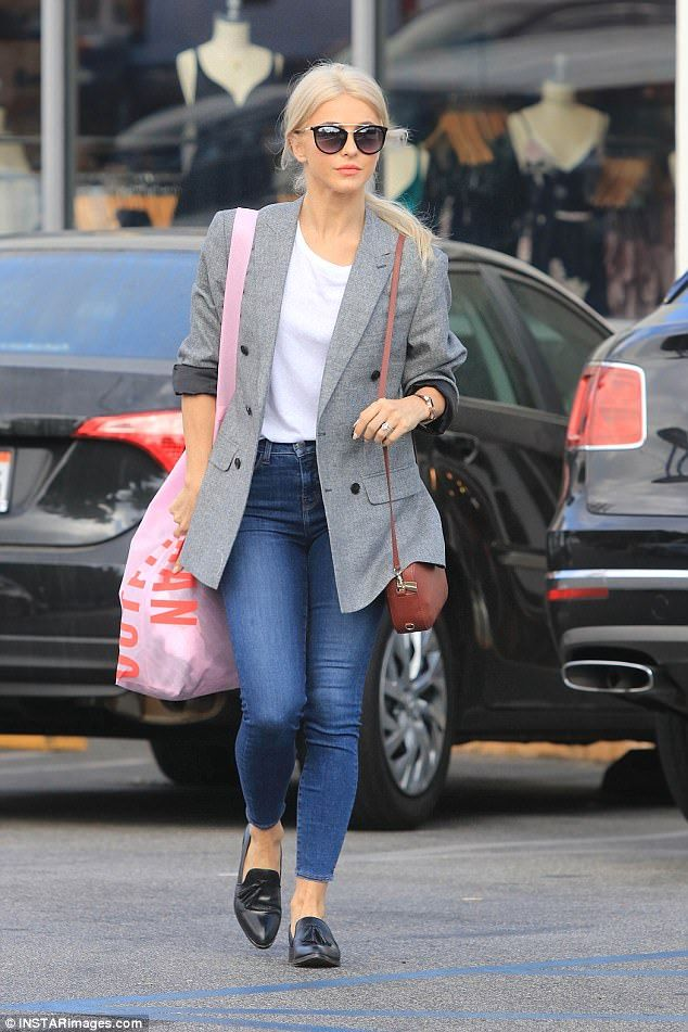 Dancing queen: The professional dancer wore a double-breasted grey blazer with charcoal li...