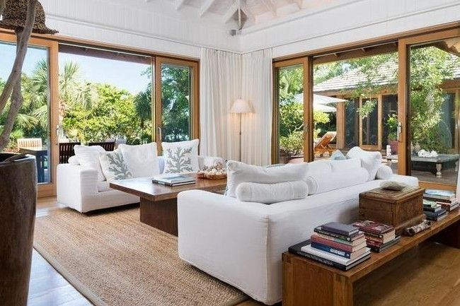 Christie Brinkley's house in Parrot Cay: The outdoors come in with large sliding glass doors leading out to the expansive pool deck.