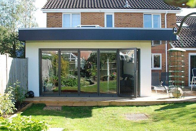 SFK70 Aluminium folding sliding doors shown from the garden with door open