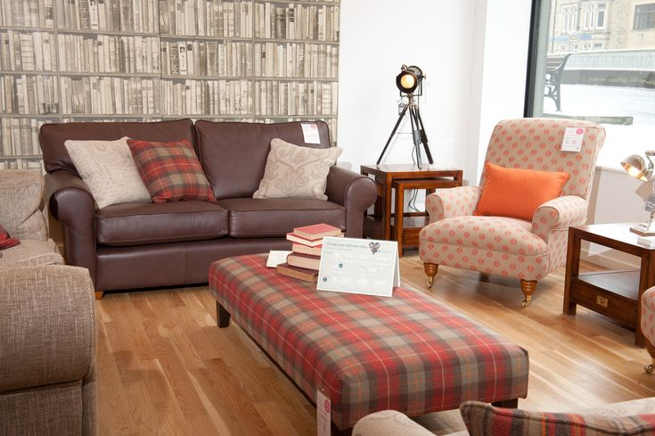 We also have many leather ranges instore here we can see for Mixing leather sofa with fabric chairs