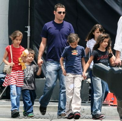 Grey's Anatomy star Justin Chambers on Sunday with his wife, Keisha (not pictured) and their five children, Isabella (white t-shirt), twins Maya and Kaila (red t-shirt and blue Paul Frank t-shirt), Eva (black t-shirt) and Jackson (grey t-shirt). After church they came across a Cat and Dog Rescue pet stand, where the family adopted a small dog.
