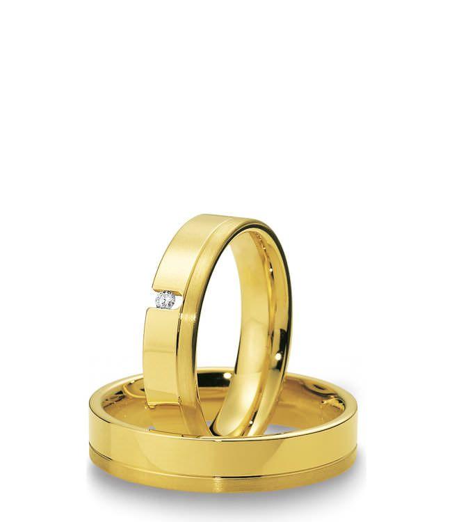 Eheringe aus Gelbgold - klassisch und elegant. Der Damen Spannring lässt den Brillanten geradezu schweben.