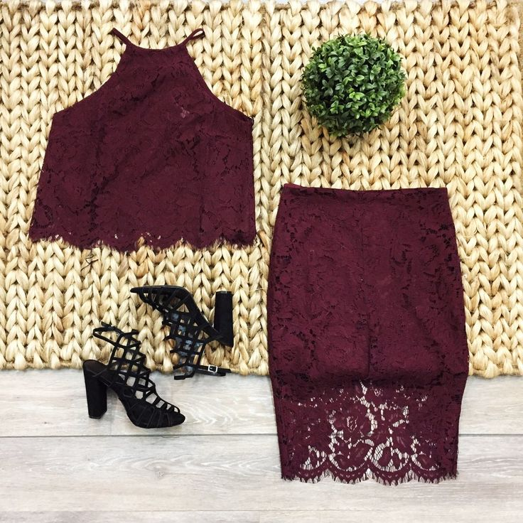 This maroon lace set is gorgeous! This top is lined with a hook and eye closure at the nape of the neck and it also has an open back. This skirt is slightly high waisted and it has a high-low hemline.