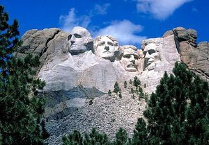 October 4, 1927: Work begins on Mount Rushmore. The monument was planned to boost tourism to South Dakota. The original plan was for statues to be carved on the granite pillars known as The Needles, featuring four Great Men: Lewis and Clark, Chief Red Cloud, and Buffalo Bill Cody.