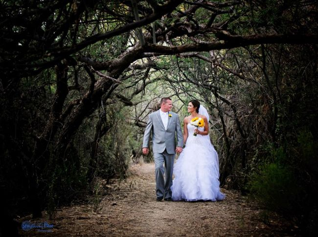 The couple describes their wedding as Classy Country- it's pretty fun! Tucson Bride & Groom Magazine, #Realwedding #Tucson Photographer: Something Blue Photography :: Floral: Elaine Taylor Fine Flowers :: Cake: Village Bakehouse :: Ceremony and Reception Venue: Tanque Verde Guest Ranch #sunflowers #yellow #wedding #Weddingvendor
