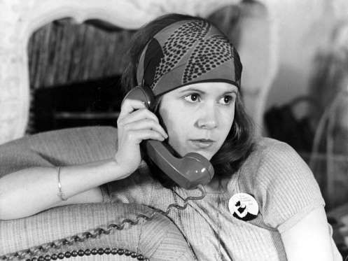 Carrie Fisher chatted on the phone in a scene from her first film, 1975's Shampoo. - Copyright (c) Mary Evans Picture Library 2009