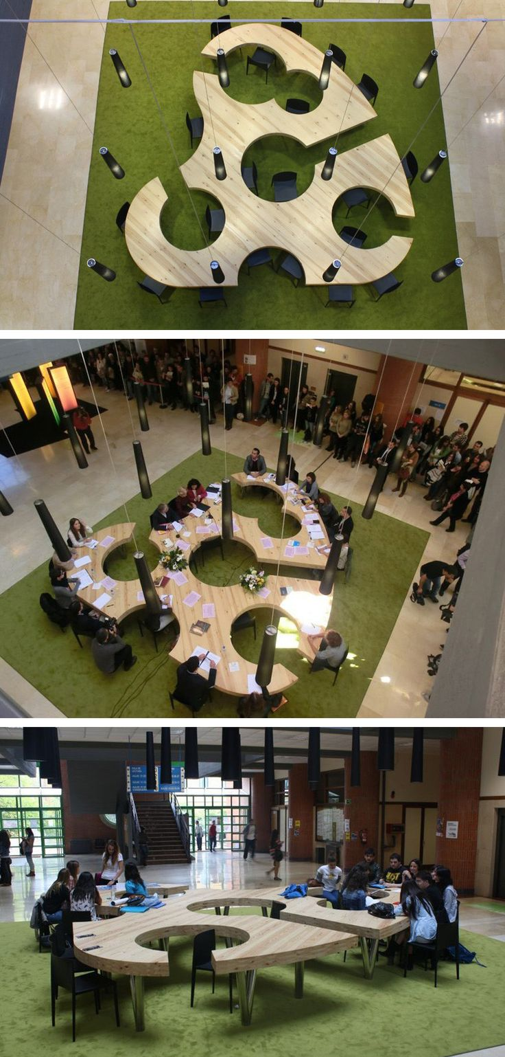 Menéndez and Gamonal Arquitectos have designed large meeting/gathering table inspired by an artists palette, for the Classroom Building in the Milan Campus at Oviedo University in Asturias, Spain.
