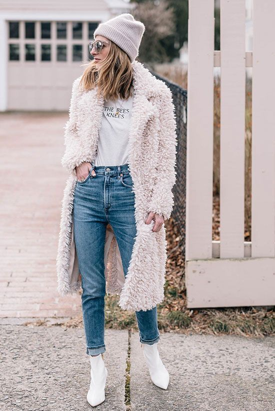 10 Chic Teddy Coat Outfits Worth Recreating: Fashion blogger 'Jess Ann Kirby' wearing a cream beanie, a white teddy coat, a white graphic t-shirt, high waist skinny jeans, white sock booties and mirror sunglasses. Teddy coat outfit, teddy coat trend, winter fashion, fashion, fashion 2018, fashion trends 2018, street style, casual outfit, casual winter outfit, winter whites, white booties outfit. #socksoutfit #casualchicfashion #wintercoatsoutfits