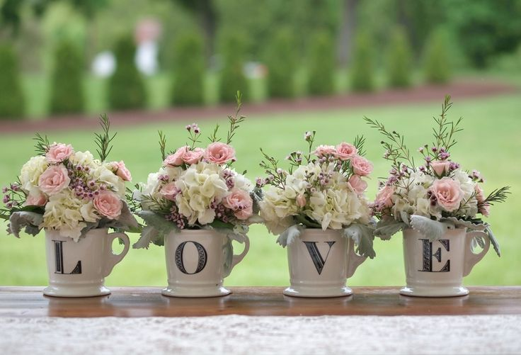 """Flowers in teacups that spell out """"LOVE"""" were the sweetest shabby chic detail! 