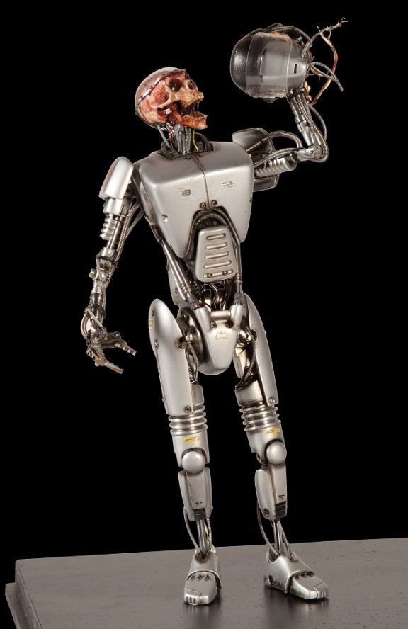 """The two failed Robocop prototypes were designed by Craig Davies.   CRAIG DAVIES: """"In designing them, I thought in terms of what would be the most terrible thing to have happen to you, and that led me to the two designs -one was a head that has been chopped off and stuffed inside a diving bell; the other was a person completely encased in metal, with only little slits for eyes and a slit for a mouth and nothing more."""""""