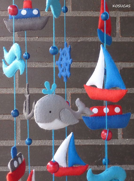Felt mobile with ships and whales.