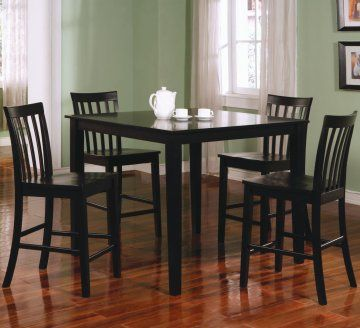 This lovely Square Black Counter Height Dining Table Set by True Contemporary will be the perfect addition to your casual contemporary home. The simple set features a smooth square counter height table, with sleek square tapered legs. The four matching counter height chairs have vertically slatted backs, contoured wooden seats, and square tapered legs for a sophisticated look.