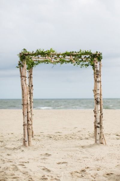 Driftwood ceremony Chuppah: http://www.stylemepretty.com/massachusetts-weddings/mashpee/2015/02/16/whimsical-cape-cod-beach-wedding/   Photography: Melissa Robotti - http://www.melissarobottiphotography.com/