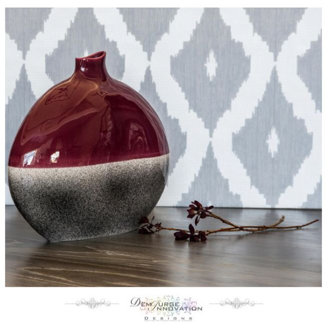 The bulbous shape and fluid lines of this vase are stunning to the eye and it's finished to perfection with the use of contrasting colours. The clean gloss of the top half sits beautifully with the neutral grey gloss of the lower half. Display in a simple line of three for a scene of instant harmony - Available Now #InteriorDesign #InteriorDecoration #LuxuryLiving #Furniture #HomeJewellery #Stylish #Quality #Elegant #Modern #Trend #HomeFashion #DemiurgeInnovationDesigns