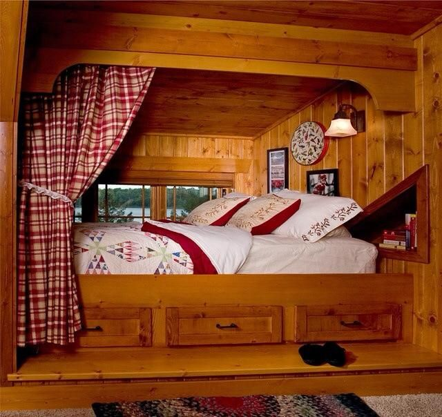 cozy little bed nook with built in cubby storage and curtain