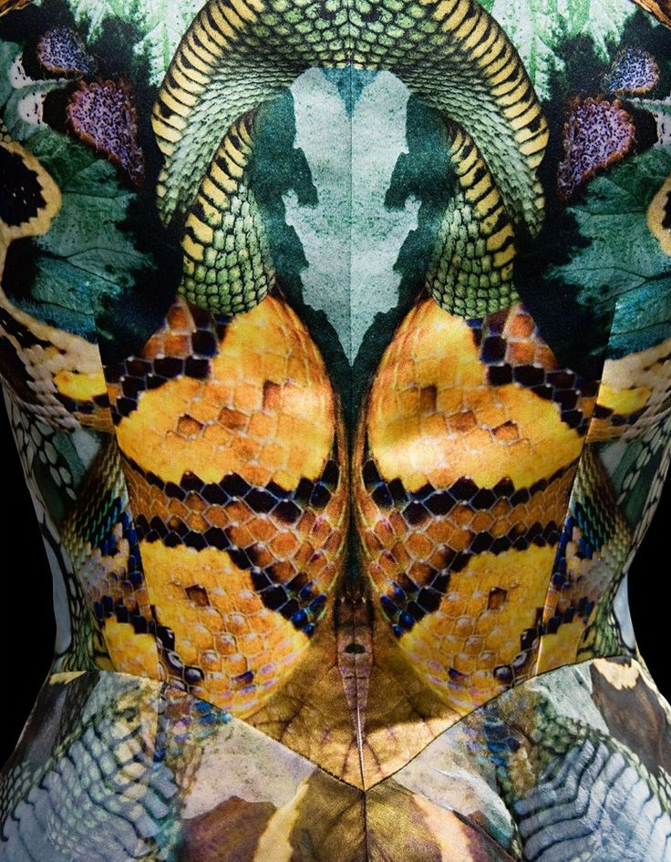 Snakeskin digital print dress with high contrast vivid pattern symmetry; mirror print fashion. Alexander McQueen