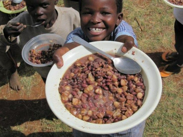 Rebekah happy with her meal for the day. Eldoret, Kenya
