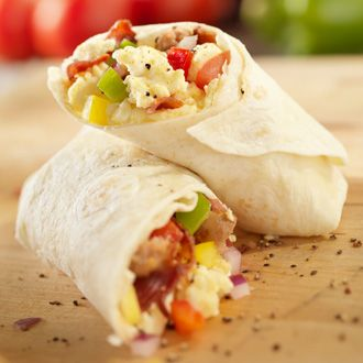 Jillian Michael's healthy breakfast burrito (only 200 calories per serving)! I made a triple batch, srapped them in wax paper and then froze them. They warm up great. I serve with salsa.