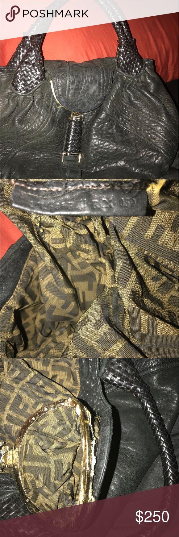 Authentic Fendi bag Black Fendi Spy bag.  Secret compartment came a loose sink glued it back together.  Bag still has lots of life in it. Fendi Bags Satchels